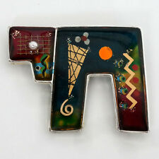 Silver tone free shape brooch with abstract picture and shape covered... Lot 54K