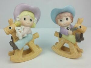 homco 1417 cow boy  girl figurines riding rocking horses