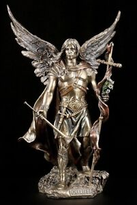 archangel gabriel figure with rod and trumpet angel