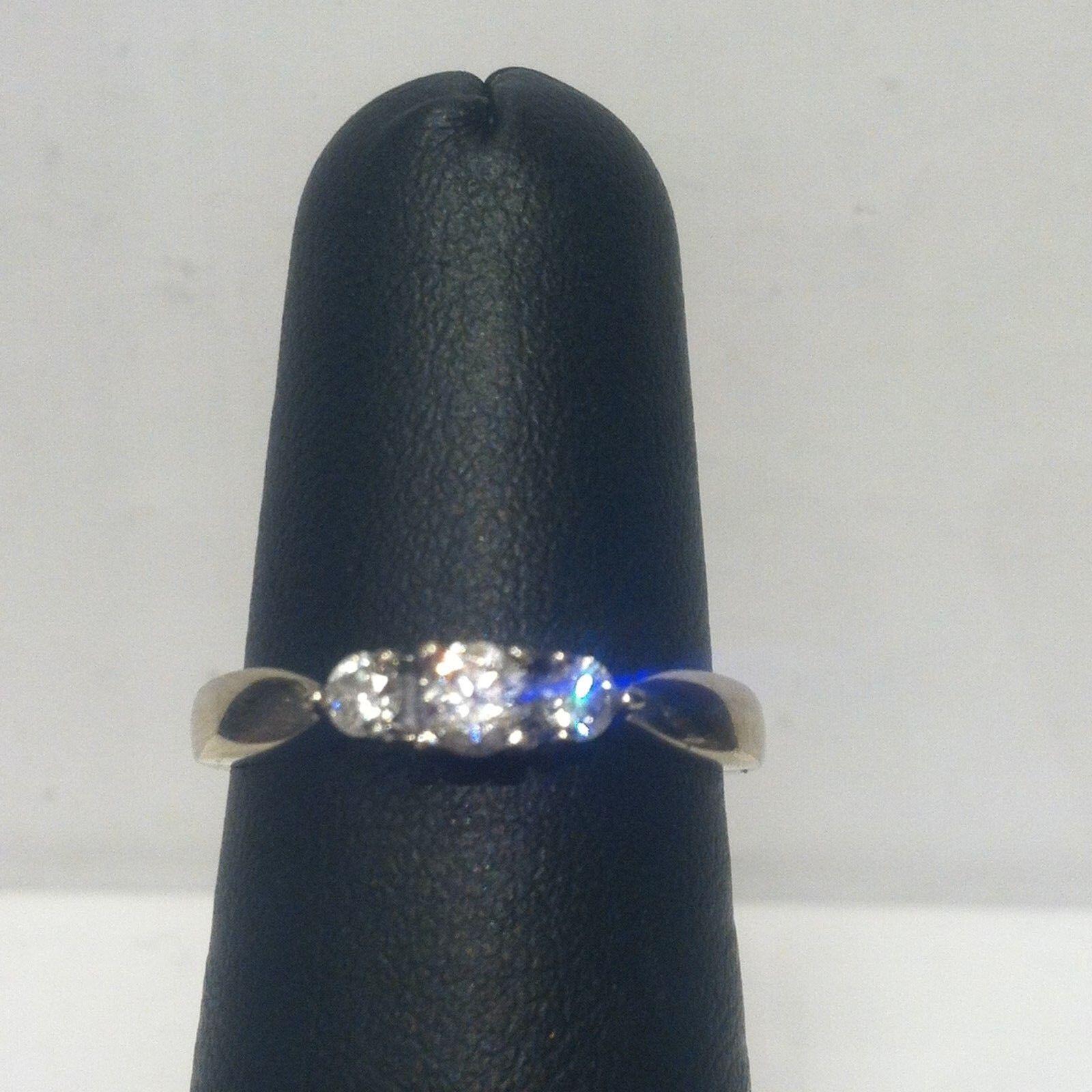 (RI1) 14k White gold Three-Stone Diamond Ring .29 TCW 2.9 Grams 5.75 Size
