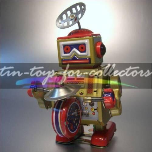 LITHOGRAPHIERTES FEINBLECH MIT UHRWERK ROBOTER BAND N0 2