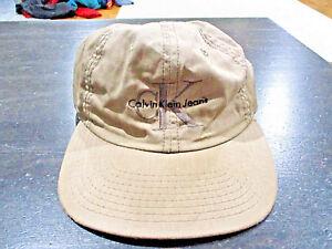 9ba4983b30f VINTAGE Calvin Klein Jeans Snap Back Hat Cap Brown Tan CK Spell Out ...