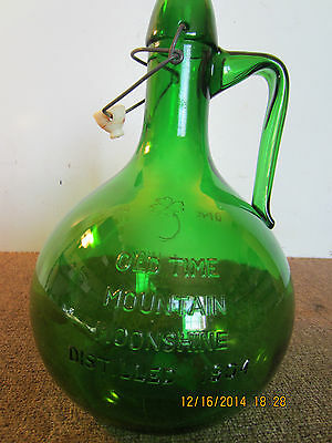 "VINTAGE ""OLD TIME, MOUNTAIN MOONSHINE"" BOTTLE"