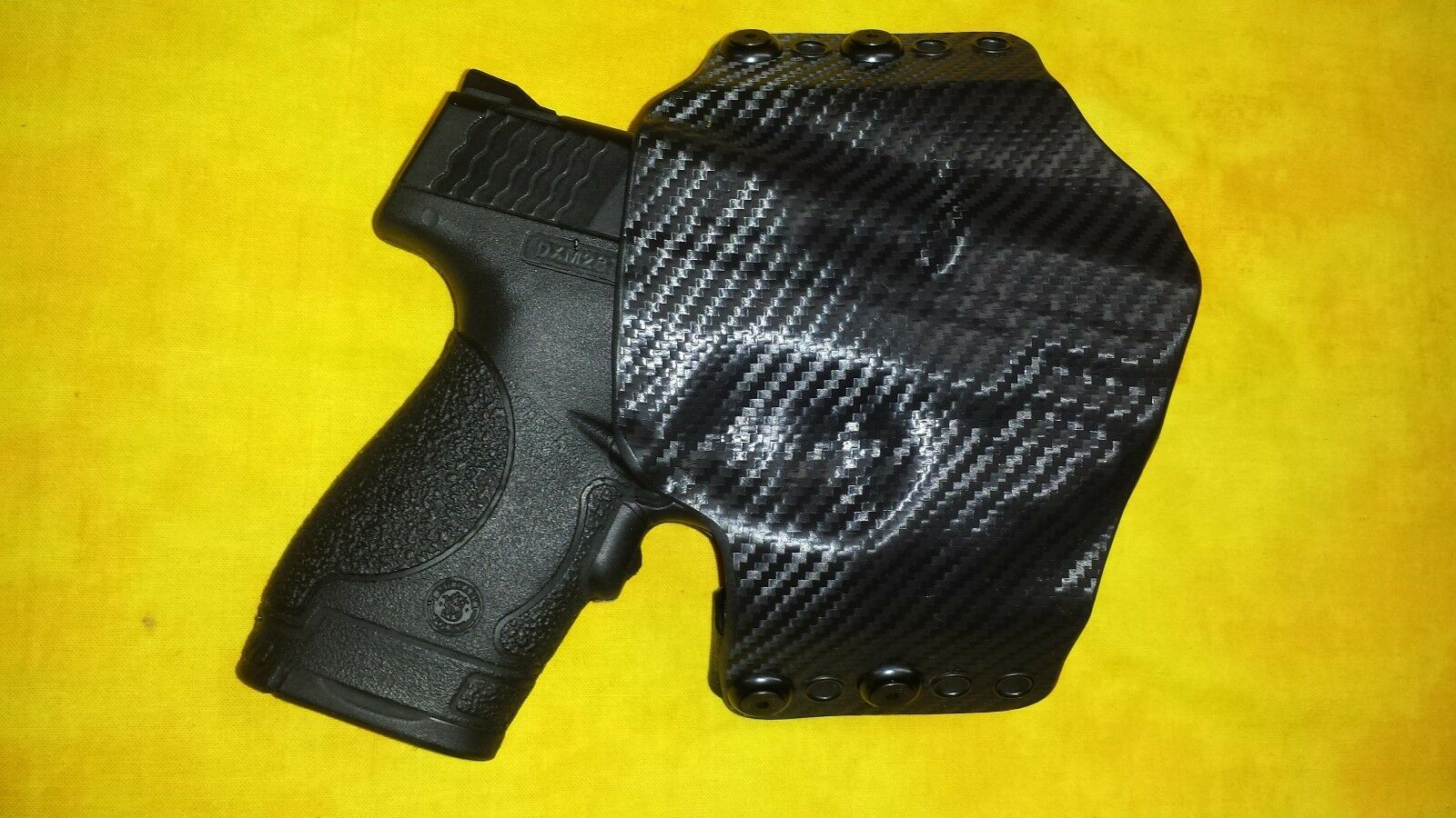 Funda NEGRO CARBON FIBRA KYDEX se ajusta S&W M&P Shield con CRIMSON TRACE