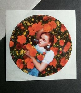THE-WIZARD-OF-OZ-JUDY-GARLAND-DOROTHY-SLEEPING-IN-FLOWERS-LAYING-MOVIE-STICKER