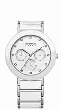 Ladies Bering Silver White Ceramic Band Swarovski Day and Date Watch 11438-754