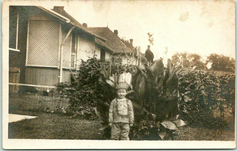 Vintage 1910s RPPC Real Photo Postcard Little Boy in Indian Costume / House Yard