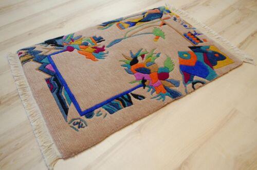Nepal Teppich YSSIMA Nini Ferrucci 9361 60x90 cm bunt Designer B
