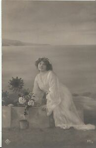 Glamour-Postcard-Young-Lady-Sitting-On-Wall-With-Potted-Rose-A5224
