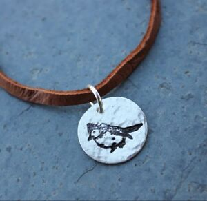 Sterling Silver Hoop pendant with small Turquoise cabochon on brown suede leather cord
