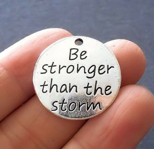 """4pcs-/""""Be stronger than the storm/"""" Charm silver tone round tag charm"""