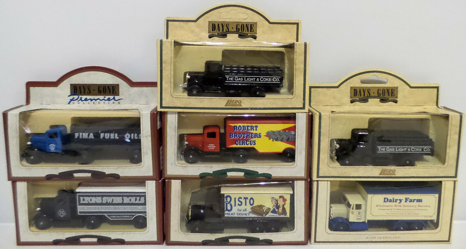 VEHICLES   SET OF 7 ADgreenSIING LORRIES MADE BY LLEDO (DT)