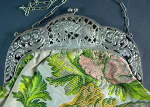 prunkvolle-Handtasche-Silberbuegel-mit-Puttodekor