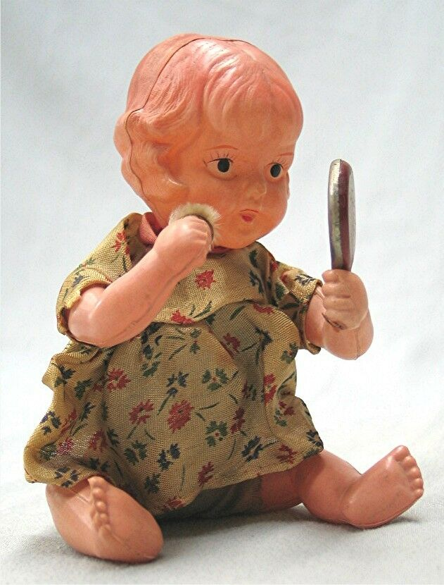 Vintage 1930's 1930's 1930's Wind Up Celluloid Baby Girl with Mirror and Powder Puff fcb6c0