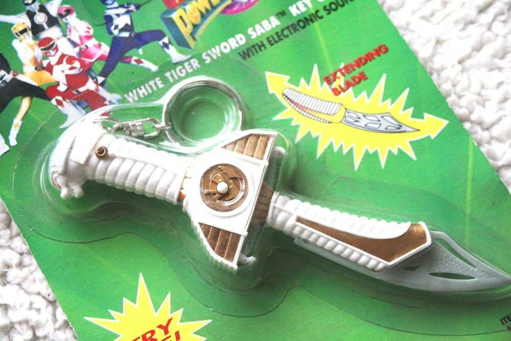 POWER POWER POWER RANGERS  WHITE TIGER SWORD SABA KEY CHAIN (1993). BRAND NEW IN BLISTER  6ff6a6