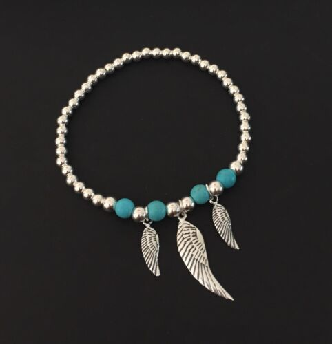 Sterling Silver And Turquoise Beaded Stretch Bracelet With Angel Wing Charms