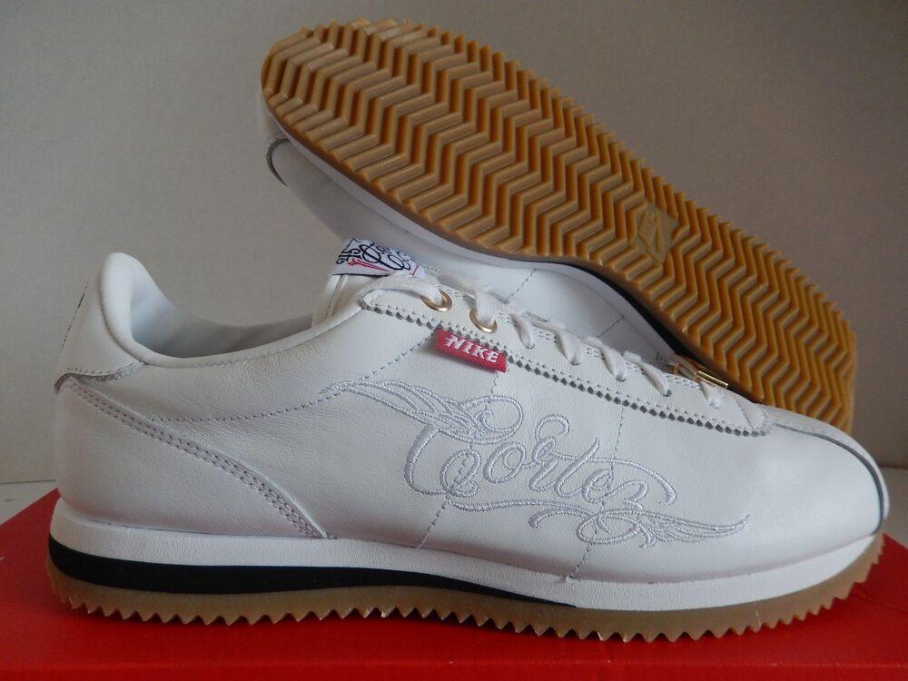 09d13ac72db NIKE CORTEZ BASIC MC QS MR CARTOON blanc -Noir-BROWN Chaussures de ...