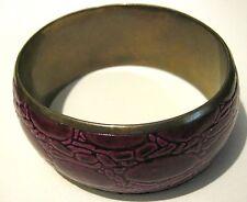 Fantastic bangle style bracelet with purple faux snake skin pattern exterior