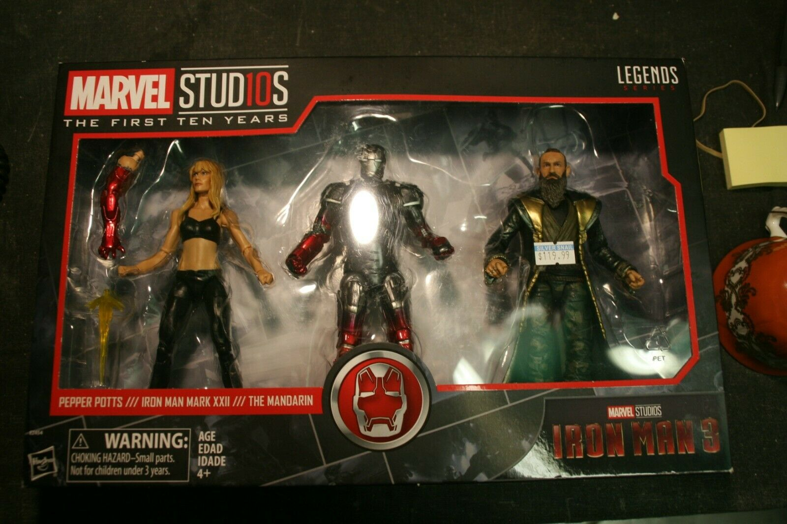 A Hasbro Marvel Legends Series Iron Man 3 Action Figure Set in Sealed Box