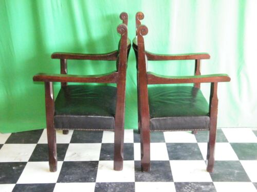 A Pair Of Oak Leather Carver Chairs