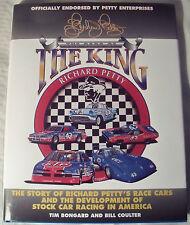 Richard Petty signed book Richard Petty The Cars Of The King HC DJ Tim Bongard &