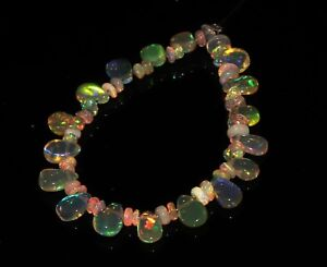 8-00-TCW-4-034-NATURAL-ETHIOPIAN-FIRE-OPAL-ALMOND-WITH-ROUNDEL-BEADS-DEMI-STRAND