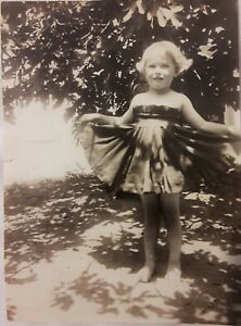 Vintage Old 1920's Photo of Funny Little Girl Holding her Skirt up Like a Fan