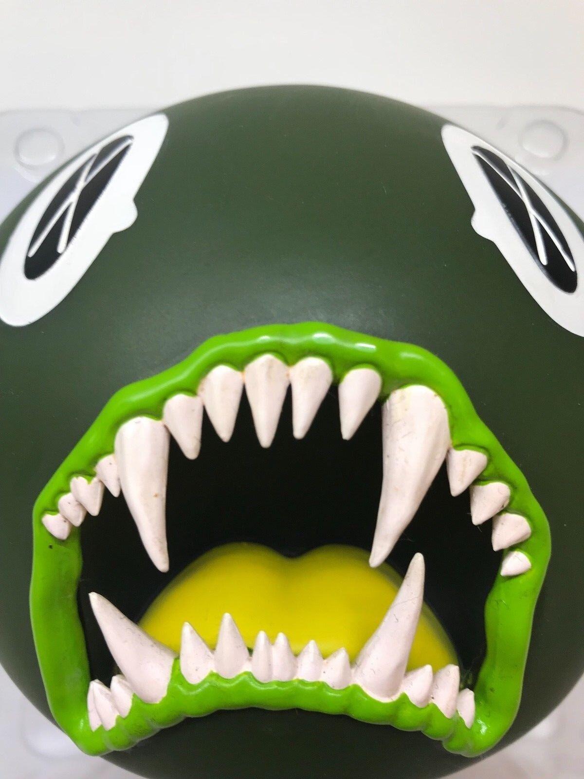 KAWS Cat Teeth Bank  verde , 2007