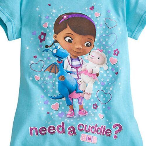 "DISNEY STORE DOC MCSTUFFINS GIRLS TEE T-SHIRT NWT GLITTER  /""NEED A CUDDLE?/"""