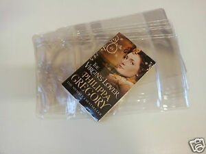 3-x-PAPERBACK-TEXT-BOOK-BOOK-COVERS-180mm-clear-plastic-reusable