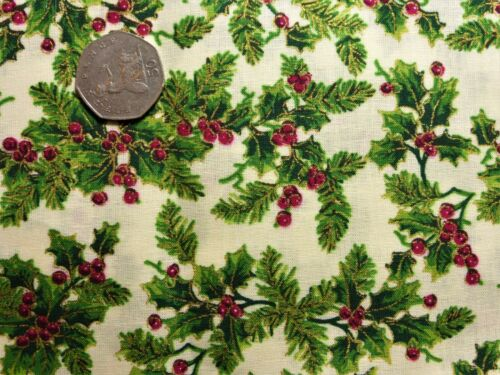 metre cotton with holly and fir in green with red berries and gold on off-white