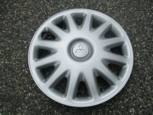 One factory 1994 to 1998 Mitsubishi Galant 14 inch hubcap wheel cover