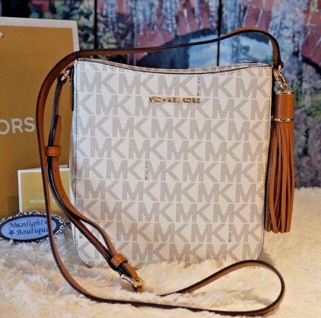 b6de59e63a Michael Kors Bedford Tassel Crossbody Bag MK Signature Messenger Vanilla