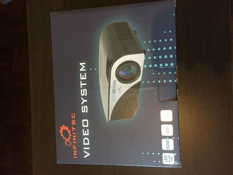 """Great bargain! Infinitec video projector with 72"""" Projector screen up for grabs!!"""