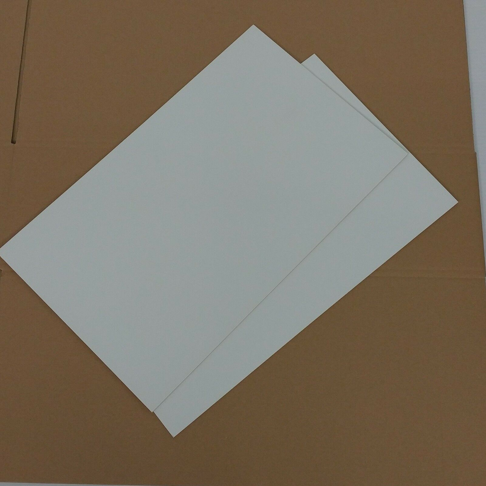 388 Zwischenlagen//Zuschnitte Graupappe 0,5mm; 54x36 cm für Euroboxen ca