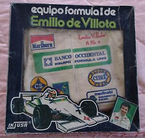 INJUSA-EQUIPO-FORMULA-1-EMILIO-DE-VILLOTA-MONO-OFICIAL-TALLA-1-TRAJE-NUEVO