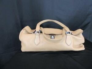 PRADA Tan Pebbled Leather Fold-Over Flap Buckle Shoulder Satchel ... 96cae6f9daa4d