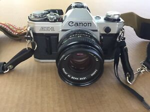 Canon AE-1 35mm SLR Film Camera with Canon 50mm f/1.8 FD Lens - WORKING GREAT!