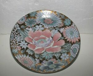 Round-plate-with-gold-painted-Peony-flowers-on-it-Plate-is-named-Golden-Peony