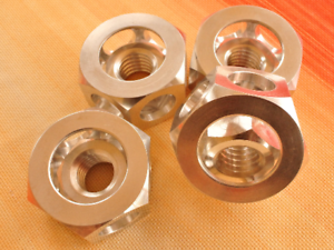 Aluminum nut in a nut, turner's nut puzzle