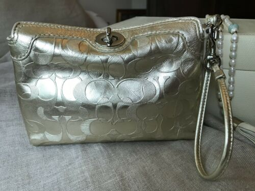 COACH Metallic Gold Embossed Leather Wristlet