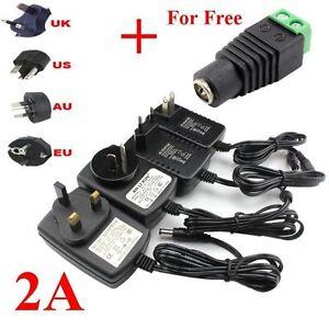 Ukeu plug 2a power adapter transformer dv 12v for led light strips image is loading uk eu plug 2a power adapter transformer dv aloadofball Images
