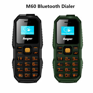 Hanging-Ear-Mini-Mobile-Cell-Phone-GSM-Bluetooth-Dialer-Dual-SIM-Flashlight-TC