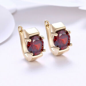 Sterling-Silver-Created-Ruby-and-White-Topaz-Oval-Halo-Stud-Earrings