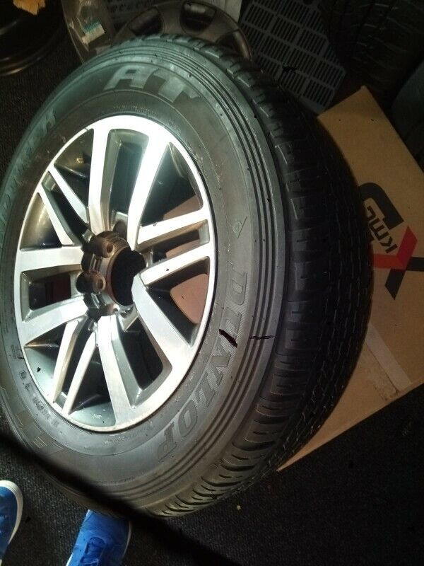 """18"""" Toyota Hilux/Fortuner original mag with used 265/60/18 Dunlop AT to use for spare R2800"""