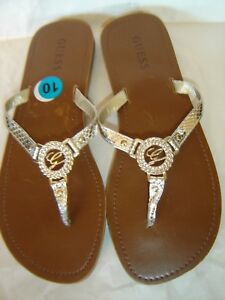 9d37d174fba27 GUESS WOMEN S FLIP FLOPS THONGS TAN SIZE 10 WITH SILVER STRAPS   G ...
