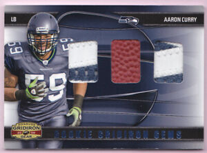 AARON-CURRY-RC-2009-GRIDIRON-GEAR-RC-GEMS-DUAL-2CLR-PATCH-BALL-01-50-SEAHAWKS