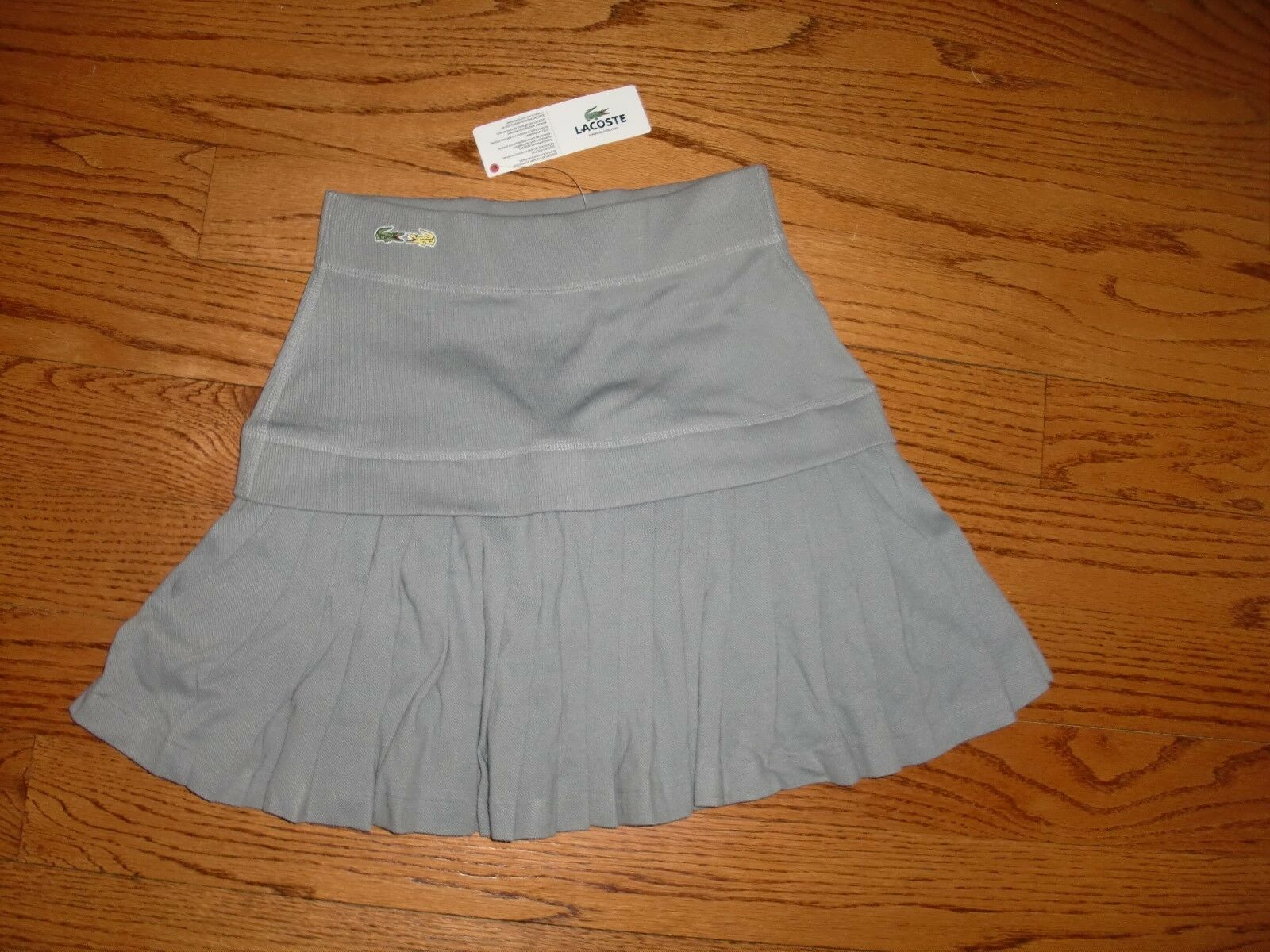 NWTMade in FRANCE 165.00LACOSTEPLATINUM COLOR Pleated Logo Skirt size XS
