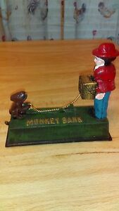 MECHANICAL CAST IRON MONKEY BANK