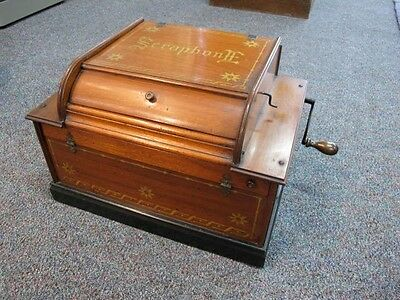 SERAPHONE HAND ORGANETTE, ENGLISH AUTOMATIC C1890'S WITH EXTRA ROLLS.